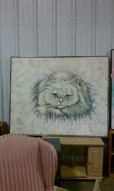 """A HUGE """"over the sofa"""" painting of a cat. I shudder to imagine what this """"matched""""."""