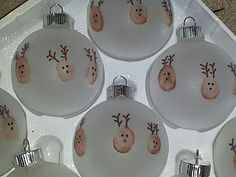 Reindeer ornaments using kids thumbprints. Write their names and the year on the back for a great memento!
