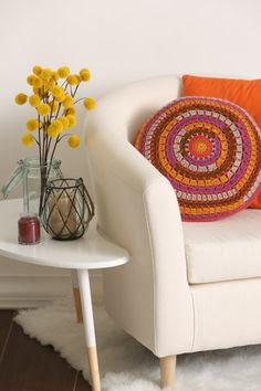 """The word equinox translates to """"equal night,"""" meaning night and day are about the same length of time. To capture this effect, this pillow pattern mixes dark and light colors equally, alternating autumnal hues in rings to make a dynamic accent for the home."""