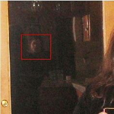 An apparition looking in at me (my hair and right shoulder visible) while I was inside interviewing another spirit. Taken in Genoa, Nevada