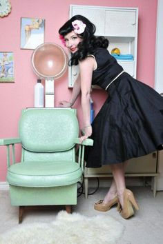 Pinup Fashion: black swing dress and orchid hair flower
