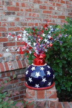 Firecracker made with upside down flower pot and weighted star spray