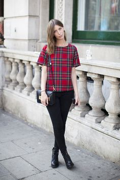 Love this posh punk look with its A-line checked top and delicate leather goods.