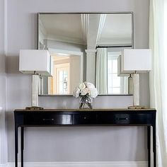 Chi foyer with bold black paint color, glossy black lacquer modern console table with gold trim and Etsy 13 West Design Chanel Print. Wooden Console, Modern Console Tables, Foyer Tables, Black And Gold Living Room, Hallway Console, Foyer Design, Entryway Decor, Decoration, Room Decor