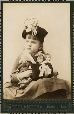 Vintage photo of a Girl with her two dolls