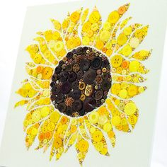 Add a burst of sunshine to any room with this gorgeous bespoke sunflower wall hanging! Expertly crafted with a collection of golden, yellow, and chocolate brown embellishments this slice of spring will accent any room with love and light.  Your sunflower wall hanging measures 12 x 12 inches and was crafted on an art board covered with 100% cotton cream colored Aida cloth. This high quality fabric not only gives your new button art piece a soft and elegant finish, but also greatly increases…