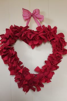 Scraps of fabric on a hanger bent into a heart.