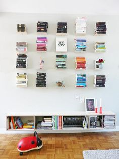 Mount a lofty library with an arrangement of floating shelves. #etsy
