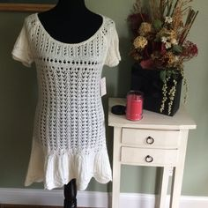 NWT FREE PEOPLE IVORY MINI SWEATER DRESS or TUNIC This FREE PEOPLE SWEATER DRESS IS BEAUTIFUL. ITS ALL KNIT WITH IVORY YARN. ITS A MINI WITH A SOLID BOTTOM AND ARMS. THE REST OF THE DRESS IS SEE THROUGH. LARGE ROUND COLLAR. NWT. CAN BE WORN AS A TUNIC AS WELL Free People Dresses Mini