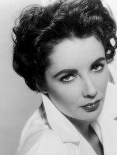 Elizabeth Taylor. Apparently I resemble her.