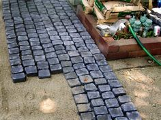 An old concrete patio with a mismatched paver extension gets a completely different look with a stylish cobblestone overlay. Learn how to make it yourself on DIYNetwork.com.