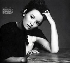 """emily browning's inner arm tattoo: """"a blessed unrest that keeps us marching"""""""