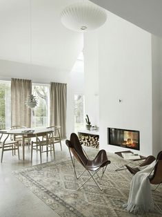 Bright living space with vaulted ceilings and fireplace