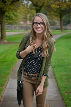 Women's Olive Open Cardigan, Black and White Polka Dot Button Down Shirt, Black Leather Belt, Black Leather Crossbody Bag, and Brown Skinny Jeans