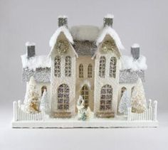 """Dreaming of a white Christmas? 17.5"""" L x 7.5"""" W x 13.5"""" H. Pressed paper, glitter, batting, bottle brush trees. Imported."""