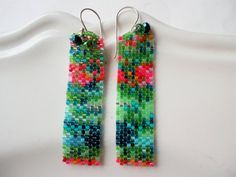Hanging earrings set in Peyote technique from precious Delica beads in free phantasy design. I sat down in a meadow with wild flowers and