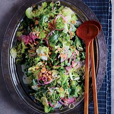 Escarole-and-Brussels Sprout Salad | Instead of roasting brussels sprouts, shredding them raw and tossing them with escarole makes for an excellent salad. The tangy buttermilk dressing is light and flavorful.