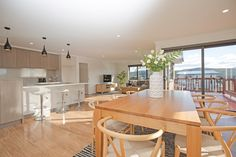 Display Home Polished Floorboards Wishbone Dining Chairs Timber Table Open Plan