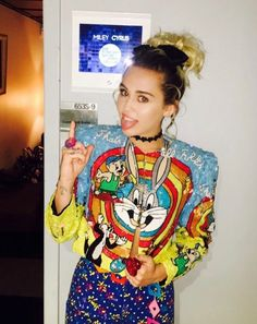Miley Cyrus wears a Looney Tunes jacket