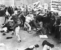 A scene depicting unionized strikers fighting with a group of 'scabs' or nonunion replacement employees as they try to cross the picket line at a factory. One of the strikers' signs reads 'We fight fascism.' Several men lay unconscious on the ground, c. 1935.  Photo credit: American Stock / Getty Images  Does anyone know where this strike occurred?