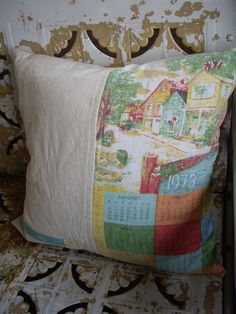 I love those old towel calendars but never know what to do with them. Fun pillows for the porch. And they used left over zipper parts for an embellishment ... zippers!