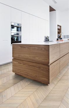 MODERN, FRESH Timber Grain Island With Thin White Benchtop And Dominant  White Cabinetry.