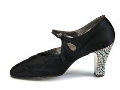 Black satin pumps with rhinestone encrusted aluminum heels. USA. 1922-24