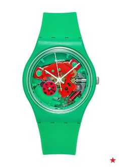 Look closely, it's a lady bug! The green band of this SWATCH watch is sure to stand out. Wear it alone or accent with your favorite bracelets.