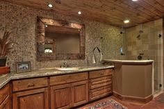 Barndominium bath. Like the shower and wood ceiling.