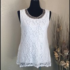 HP 06/22/16 Embellished White Lace Overlay Top Perfect for any occasion. Pretty, stretchy lace over a built in white cami. Bling accents on front of top. Easily dressed up or down, this top will be a wardrobe staple. NWT. Lavish Tops