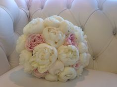 White peony bouquet with a touch of pink sweet avalanche roses