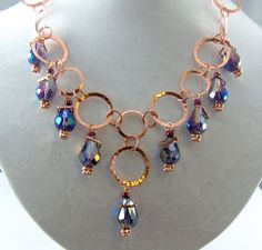 Very shimmery hammered copper loops and deep blue dangles #necklace
