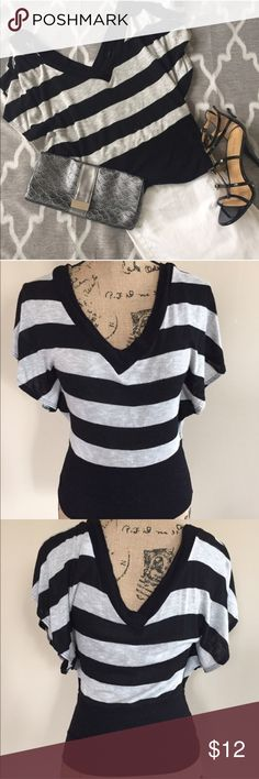 """Striped v neck/back knit top Sexy black and gray striped blouse by Body Central is a super soft knit. Deep v neck and v back are identical cut. Short dolman flutter sleeves with a solid black fitted waist. Super cute top!! Size S, polyester/rayon/spandex blend. 22"""" length Body Central Tops"""