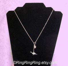Dinosaur necklace Sterling silver necklace jewelry by RingRingRing, $29.00.  Um, it's awesome!