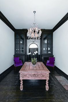 http://kikette-interiors.blogspot.com  - this whole room does it for me. Royal purple chairs, pink table and a chandelier. :)