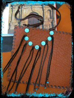 approx. 26 in length with a copper large lobster claw closure  beautiful coin turquoise beads to the front with leather fringe decorated with