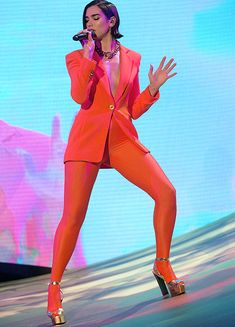 Dua Lipa performing 'One Kiss' on The Graham Norton Show wearing a red jacket, silver platform high heel sandals, and red pantyhose as pants Pantyhose Outfits, Tights Outfit, Red Pantyhose, Nelly Furtado, Colored Tights, Stage Outfits, Christina Aguilera, Female Singers, Ladies Party