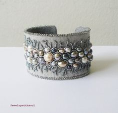 Grey lace, bead embroidery cuff bracelet with freshwater pearls in grey, silver, peacock, mauve and cream white. $140.00, via Etsy.