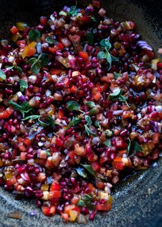 Ottolenghi combines bitter pomegranate with four types of tomato for a fresh, sweet salad.