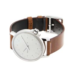 Minasi watch. I like the simple design and the combination of an old leather strap and a silver case.