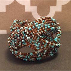Gorgeous turquoise bracelet Gorgeous turquoise and brown chunky bracelet. Adds a pop of color to any outfit. Super easy on and off. Jewelry Bracelets