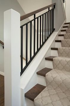 Haus-design Wood and iron staircase is lined with a gray Moroccan tiles stair runner. stairs gray hausdesign iron lined moroccan runner stair stair railing ideas Staircase Tiles Wood Stairs Trim, Tile Stairs, Staircase Railings, Staircase Design, Staircase Ideas, Banisters, Staircase Runner, Black Stairs, Basement Stairs