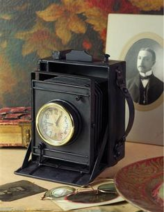 """Mimicking an old Eastman Kodak camera with bellows, this charmer switches duties. 6""""."""
