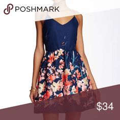 Floral Skater Dress New with tags- navy floral skater dress. Runs small Love, Zoe Dresses Mini