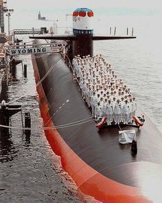 USS Wyoming (SSBN-742) commissioning ceremony, at the Electric Boat Division of General Dynamics Corp., Groton, CT., 13 July 1996. Note in the background the Archerfish (SSN-678) heading to the Mediterranean Sea for a six month deployment.