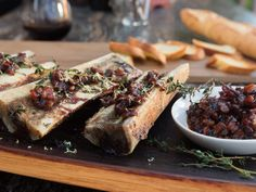 Get this all-star, easy-to-follow Bone Marrow with Bacon Marmalade and Sourdough Toast recipe from Guy Fieri