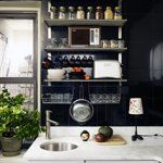 What strikes you first about Yiming Wang's renovated kitchen in her pre-war apartment is the black. Black paint? Nope. Floor to ceiling black tile, which makes for one easy-to-clean backsplash! The cabinets, faucet, stainless steel racks, and stovetop are all IKEA, while the black floor tiles were purchased for $3/each at Home Depot.