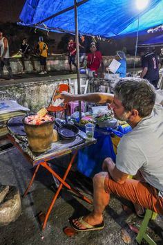 Trying my hand at grilling cheese at the night food market in Olinda, Brazil | heneedsfood.com