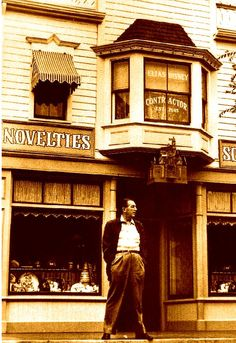 Walt Disney standing on Main Street USA, Disneyland. Note the window above him: A tribute to his father, Elias Disney. Disney Parks, Walt Disney World, Disney Pixar, Disney Couples, Retro Disney, Disney Love, Disney Magic, Disney Stuff, Jim Henson
