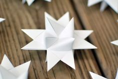 diy paper stars- my Aunt used to make these and dip them in wax and sprinkle glitter on them!